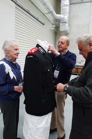 Members from St John prepare a jacket for photographing 1